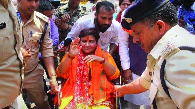 BJP candidate for Bhopal seat Sadhvi Pragya Singh Thakur arrives at the district collectors office to file her nomination papers on Tuesday. (Photo: AP)