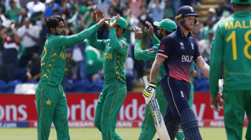Pakistan's players celebrate taking the wicket of England's Ben Stokes, right, during the ICC Champions Trophy semifinal cricket. (Photo: AP)