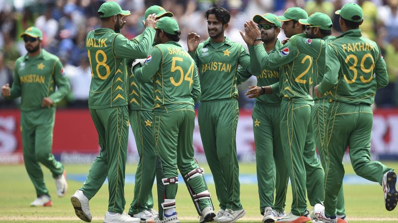 Pakistan's Hasan Ali , centre, celebrates the wicket of England's Eoin Morgan with his teammates during the ICC Champions Trophy, semifinal cricket match between England and Pakistan in Cardiff. (Photo: AP)