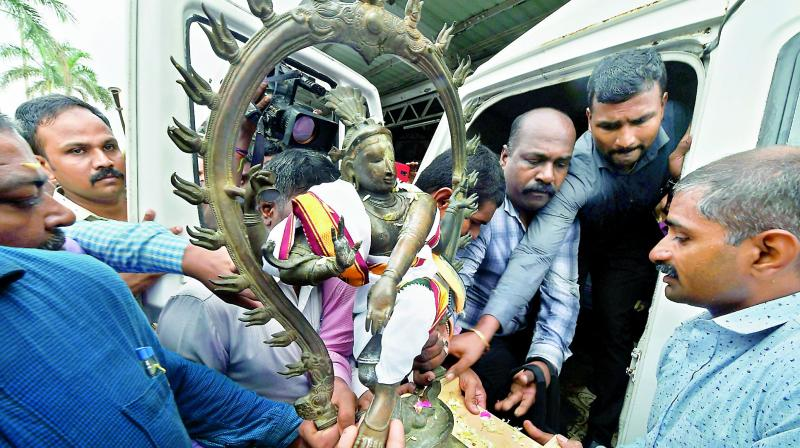 Priests perform rituals after the idol of Lord Nataraja arrived back in Chennai on Friday.  (PTI)