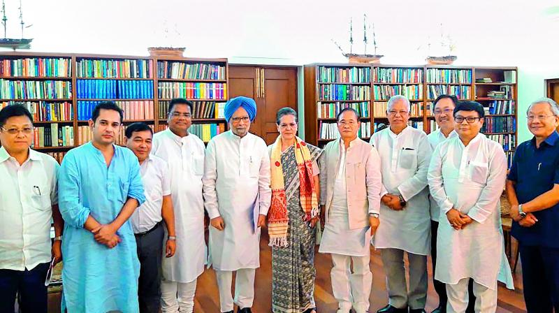 Congress president Sonia Gandhi with leaders from northeastern states in New Delhi on Friday. 	 (PTI)