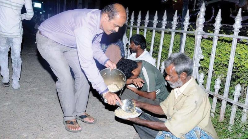AAF founder H.R. Rajendra serving food to the poor in Mysuru.
