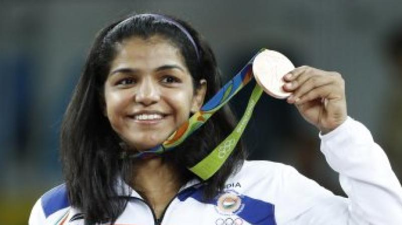 Sakshi Maliik after winning bronze medal in the Rio Olympics last year. (Photo: AFP)