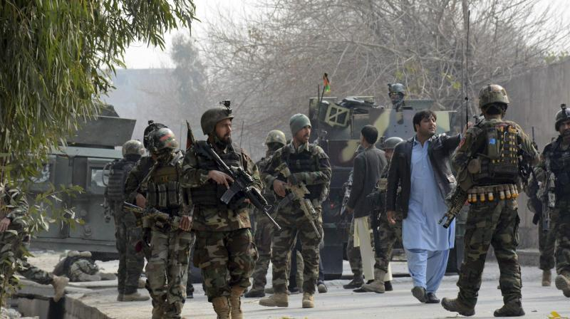 Kabul military academy hit by explosions and gunfire