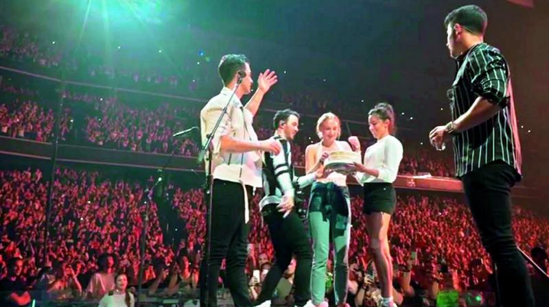 Fans at the Jonas Brothers' Concert in Washington D.C. were in for a little family treat when Joe Jonas's wife Sophie Turner turned up on stage with a cake to celebrate the singer's 30th birthday.