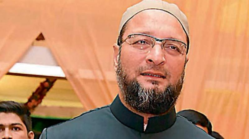 'One can stand on official occasions like 15 August, 26 January, etc,' AIMIM president Asaduddin Owaisi said. (File photo)