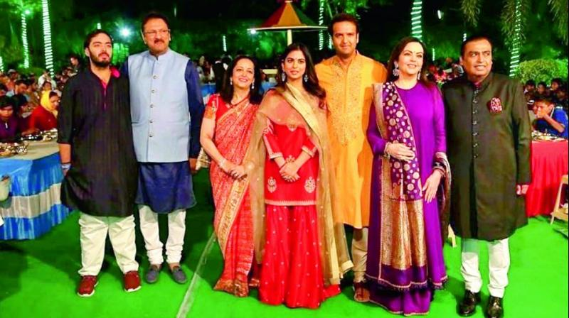 CELEBRATIONS GALORE: The Ambani and Piramal families attend pre-wedding functions in Udaipur. (Left to right) Anant Ambani, Ajay and Swati Piramal, Isha Ambani, Anand Piramal, Nita and Mukesh Ambani