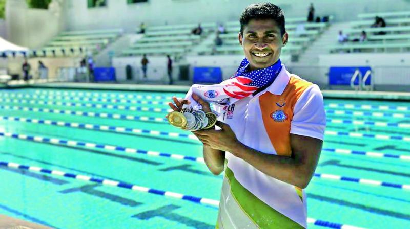 Tulasi Chaitanya with his winning medals.
