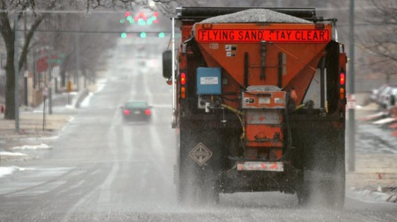 This photo shows a city truck is spreading salt on Q Street in Lincoln, Neb. Scientists are starting to raise concerns about road salt's impact on the environment, especially drinking water, because lakes and streams near roads are showing elevated levels of sodium and chloride. (Photo: AP)