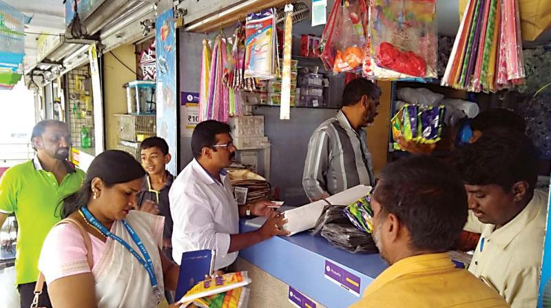 BBMP officials conducting a raid at a shop in Bengaluru.