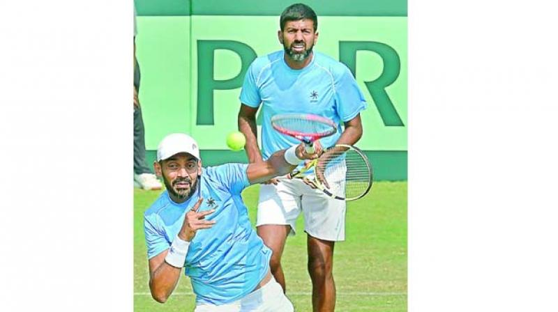 Divij Sharan and Rohan Bopanna in action against Italy's Matteo Berrettini and Simone Bolelli on Saturday. (Photo:PTI)