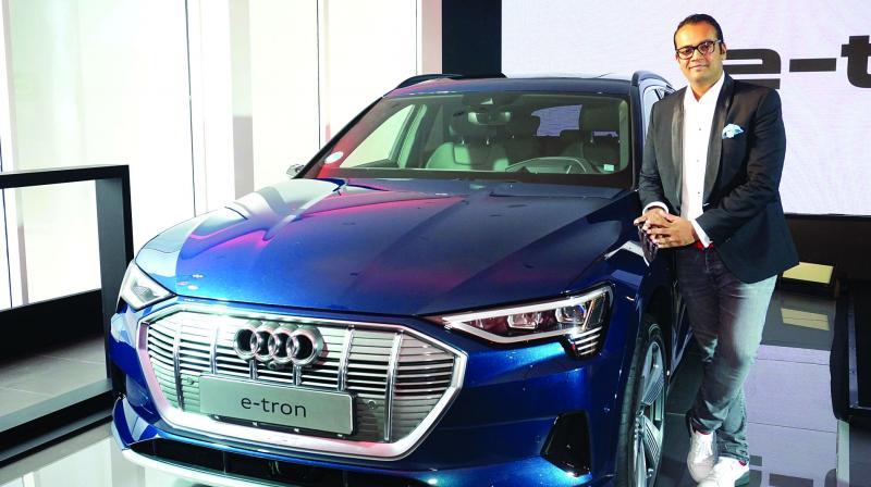 Mr. Rahil Ansari, Head Audi India posing with the Audi e-tron,  in Gurugram