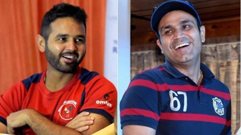 Virender Sehwag takes potshot at Parthiv Patel; Gets trolled in return