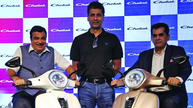 (L to R) Nitin Gadkari, Minister of Road Transport and Highways, Rajiv Bajaj, MD, Bajaj Auto and Amitabh Kant, CEO, Niti Ayog unveil the all new Bajaj Chetak Electric Vehicle