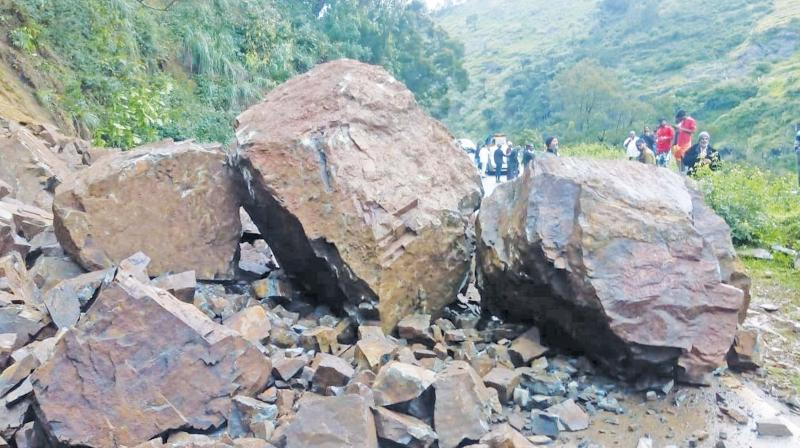 Boulders on the Ooty-Kundah road near Kundah Palam slopes as heavy rains triggered landslip there on Tuesday evening. (Photo: DC)