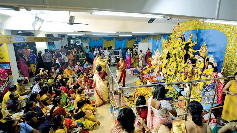 Devotees worshipping the goddess Durga on Ashtami at the Bengal Association in T Nagar. (Photo: DC)