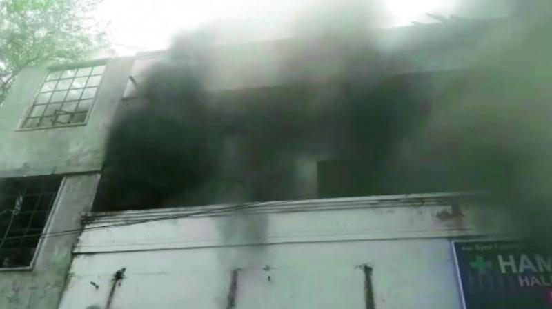 A view of the fire at a furniture godown in Tappachabutra in the city. (Photo:DC)