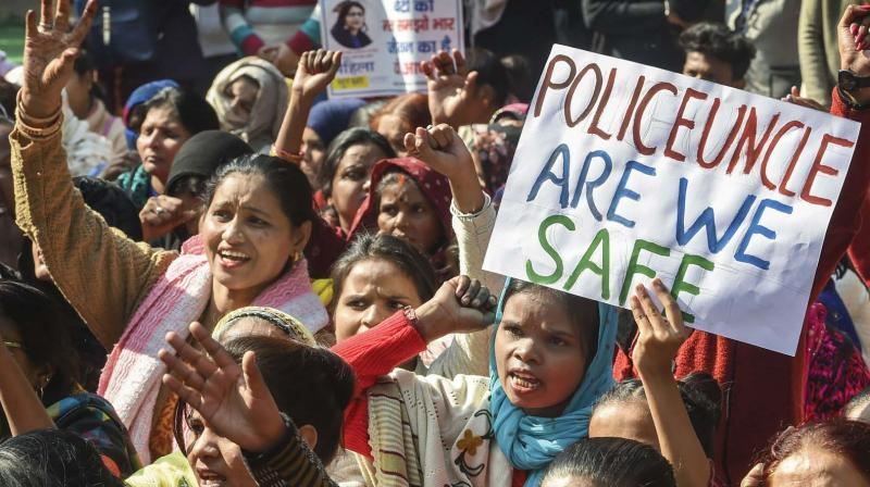 Women shout slogans during a protest of Delhi Commission for Women against the Hyderabad rape-murder case and alleged rise in the number of incidents of crime against women at Jantar Mantar in New Delhi on Tuesday. (Photo: AP)