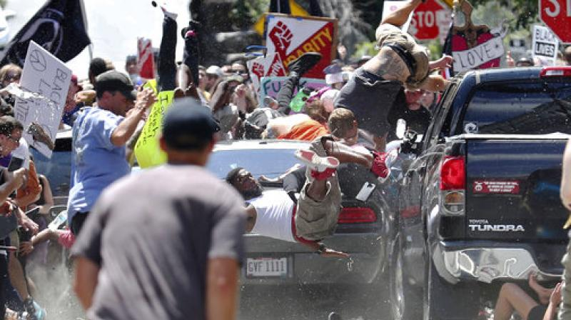People fly into the air as a vehicle drives into a group of protesters demonstrating against a white nationalist rally in Charlottesville. (Photo: AP)