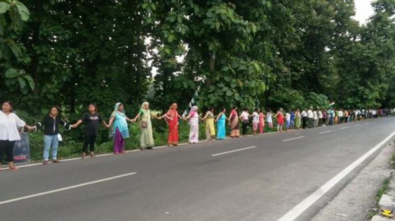 Gorkha Janmukti Morcha (GJM) activists form human chain during a protest in Sukna near Siliguri on Sunday. (Photo: PTI)