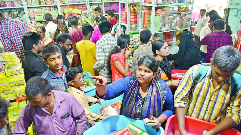 People buy crackers from a shop in Hyderabad ahead  of Diwali on Sunday.   (Photo:S. SURENDER REDDY)