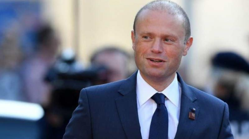 """Muscat declined to make a link with Caruana Galizia's 2017 murder, saying in a televised address that he was resigning """"as this is what needs to be done."""" (Photo: AFP)"""