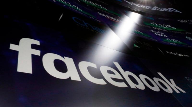 In this file photo, the logo for Facebook appears on screens at the Nasdaq MarketSite in New York's Times Square.  (AP Photo/Richard Drew, File)