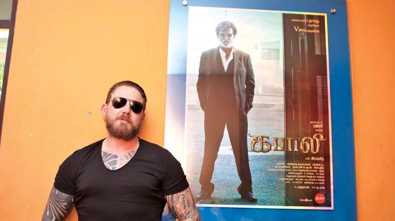 Greg poses with a Kabali poster in Chennai