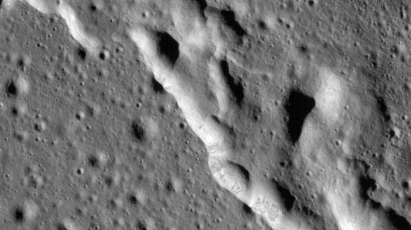Since the moon's crust is brittle, these forces cause its surface to break as the interior shrinks, resulting in so-called thrust faults, where one section of crust is pushed up over an adjacent section. (Photo: AFP)