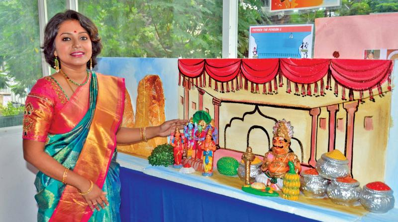 Aparna next to her creation