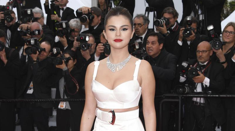 Selena Gomez was spotted on the Cannes red carpet as she made her debut this year in a pink satin ensemble. (Photo: AP)
