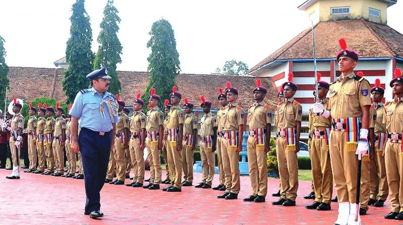 Air Marshal Rakesh Kumar Singh Bhadauria reviews the Guard of Honour during his maiden visit to Sainik School, Kazhakootam.