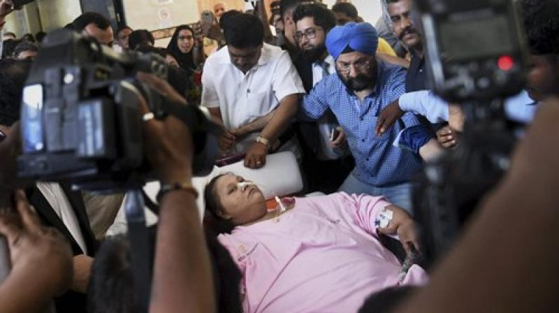 Egyptian patient Eman Ahmed, who almost spent two months undergoing weight-reduction procedure at Saifee Hospital, is being shifted to Burjeel Hospital in Abu Dhabi, where doctors will continue her rehabilitation and weight-reduction treatment, in Mumbai. (Photo: PTI)