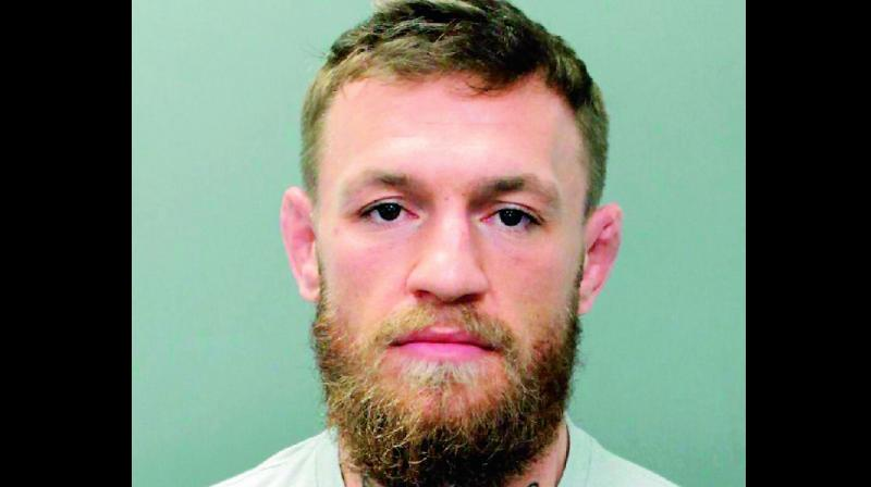 Conor McGregor is arrested 'for smashing a fan's phone'""