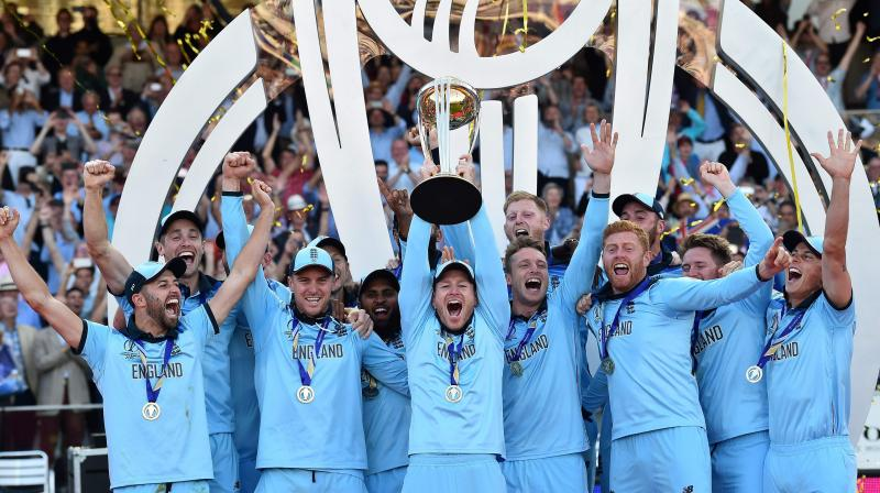 The winners, England earned a handsome USD 4 million, along with the title. (Photo:AFP)