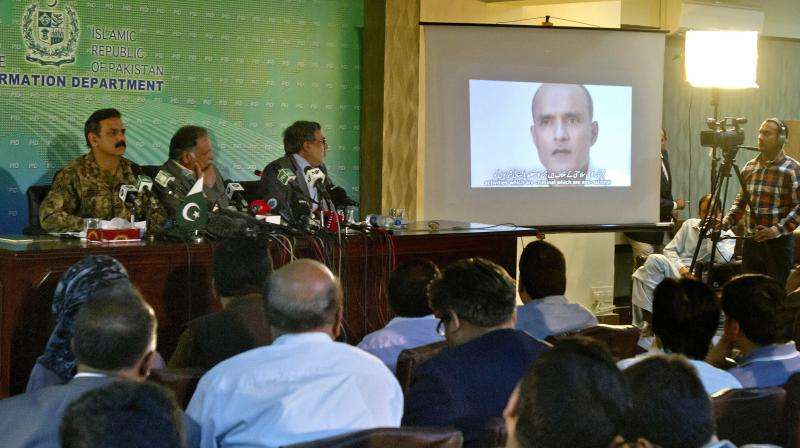 An image of former Indian naval officer Kulbhushan Jadhav being shown during a press conference by Pakistan's army spokesman and the Information Minister, in Islamabad, Pakistan. (Photo: AP/File)