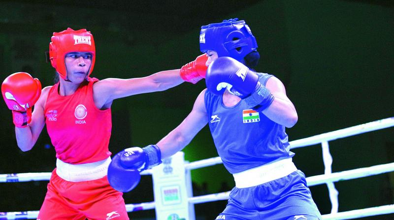 Nikhat Zareen (left) in action during her loss to Mary Kom in the India Open semifinals.