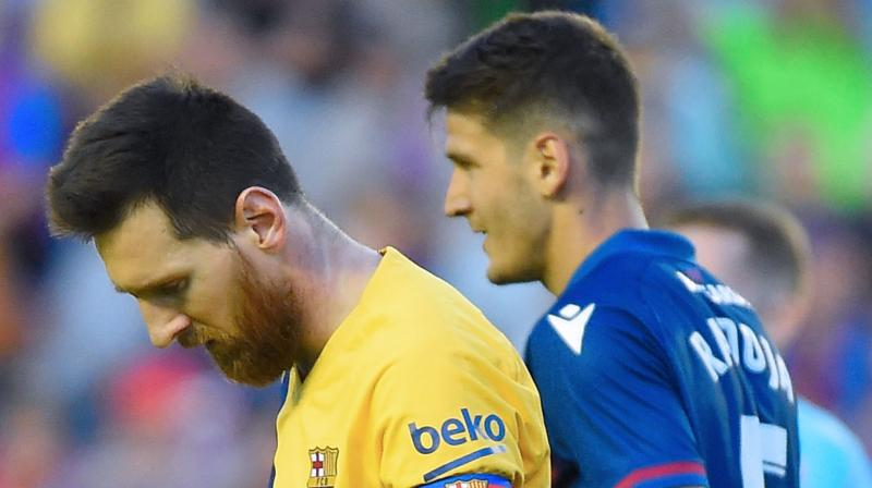 Lionel Messi scored again but was helpless to prevent Barcelona conceding three goals in seven minutes as Levante stormed to a surprise 3-1 victory in La Liga. Messi converted a first-half penalty at the City of Valencia Stadium for his sixth goal in five games. (Photo:AFP)