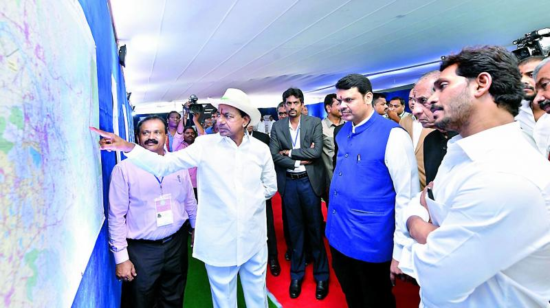 Telangana state Chief Minister briefs Governor E.S.L. Narasimhan, Maharashtra CM Devendra Fadnavis, AP CM Y.S. Jagan Mohan Reddy and others about Kaleshwaram project at Bhoopalpally on Friday.