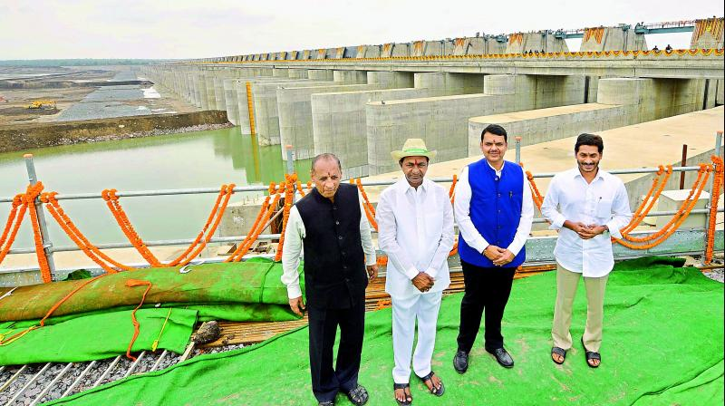 Governor E.S.L. Narasimhan (left), Chief Ministers K. Chandrasekhar Rao, Devendra Fadnavis and YS. Jagan Mohan Reddy (right) after the inauguration of the Kaleshwaram project on Friday.