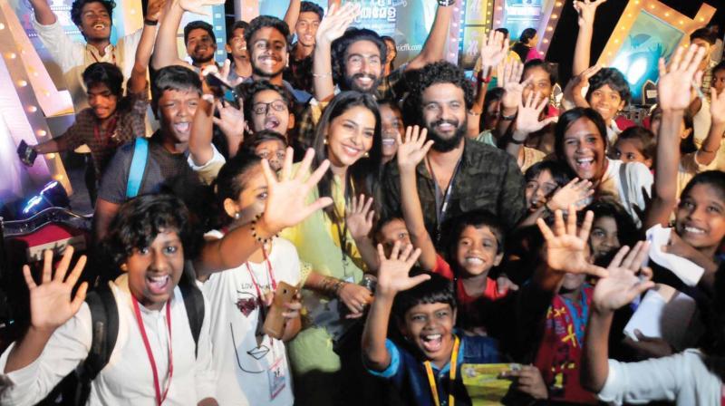 Actors Aishwarya Lekshmi and   Neeraj Madhav, with delegates during  the inauguration of Second International Children's Film Festival of Kerala in Thiruvananthapuram on  on Friday .   (A.V. MUZAFAR)