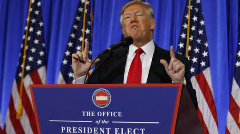 President-elect Donald Trump speaks during a news conference in the lobby of Trump Tower in New York. (Photo: AP)