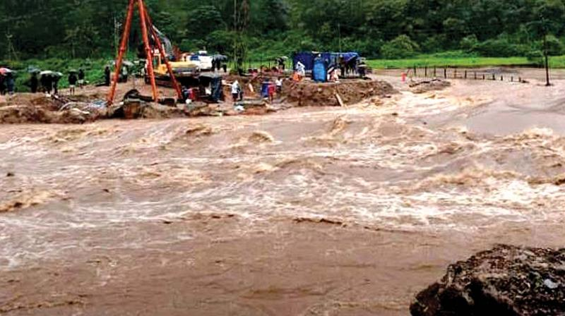 The temporary bridge at Periyavara which connects the Munnar-Udumalpet interstate route constructed after the August flood was washed away in the rains on Thursday. (Photo: DC)