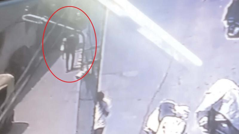 The CCTV footage, which shows the boy carrying the baby