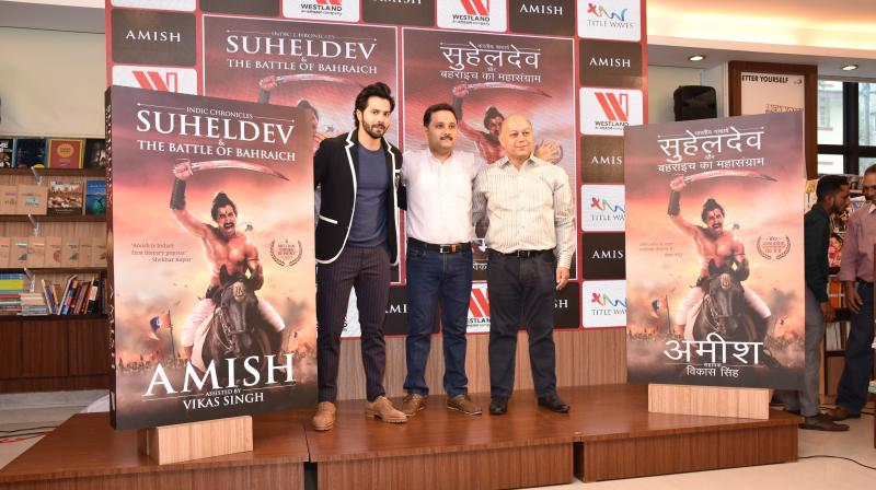L-R_Varun Dhawan, Amish,Vikas Singh at the cover launch of Suheldev and the Battle Of Bahraich.