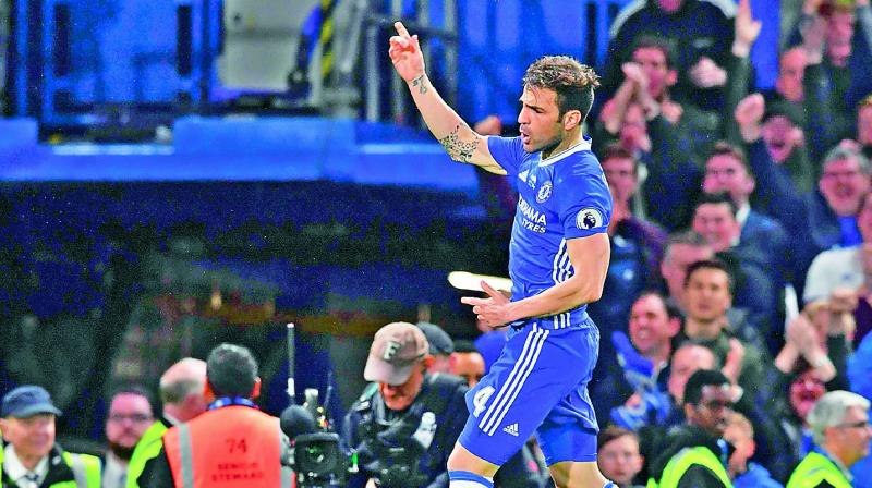 Chelsea's Cesc Fabregas celebrates after scoring against Watford in their English Premier League match at Stamford Bridge in London on Monday. The hosts won 4-3. (Photo: AFP)