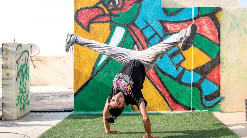 B-girl Jo performing a hand stand inverts.