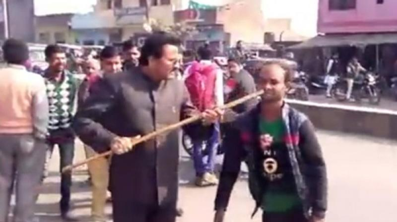 BJP leader Mohammad Miya denied the charge and said, 'I didn't shove a stick in his mouth.' (Photo: ANI)