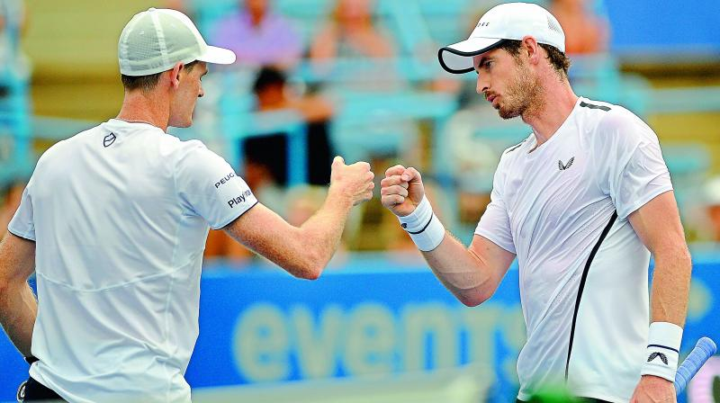 Britain's Andy (right) and Jamie Murray bump fists during a doubles match in the Citi Open tennis tournament against the French pair of Nicolas Mahut and Edouard Roger-Vasselin on Wednesday. (Photo: AP)