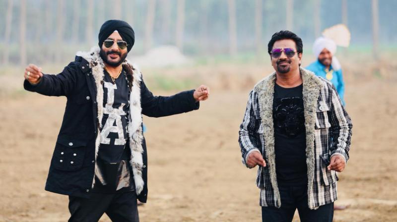 Charanjeet Singh Sondhi and Madan Maddi